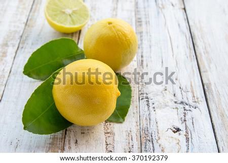 Fresh lemon on white wooden table background - stock photo