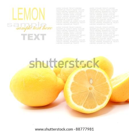 Fresh lemon with cut isolated on white - stock photo