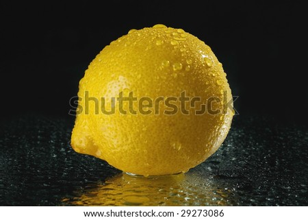 fresh lemon with drops of water