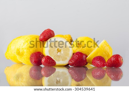 fresh lemon with strawberries on a white background