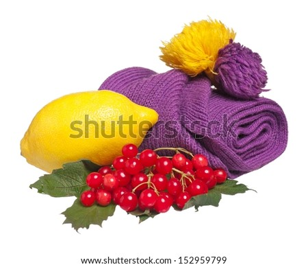 Fresh lemon with warm knitted scarf isolated on white background cutout - stock photo