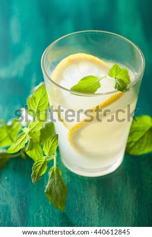 fresh lemonade drink with mint in glasses - stock photo