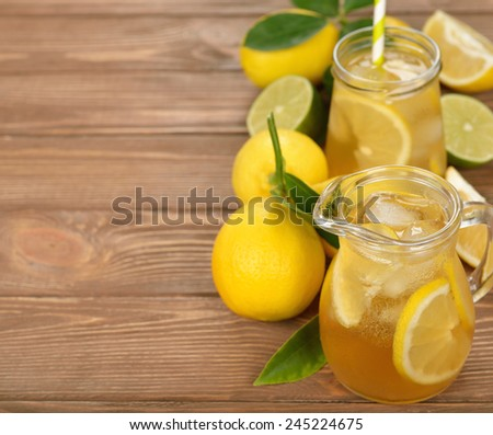 Fresh lemonade on a brown background - stock photo