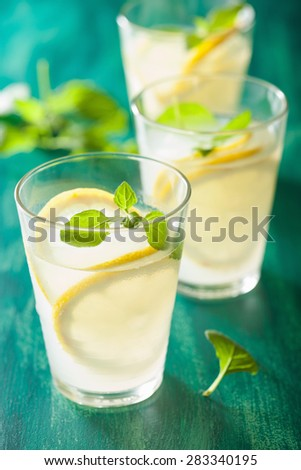 fresh lemonade with mint in glasses - stock photo
