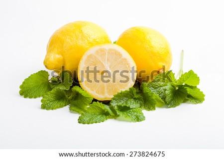 fresh lemons and lemon balm leaf on white background, isolated - stock photo