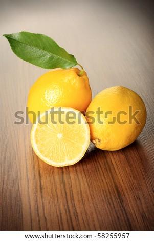 Fresh lemons on a table. - stock photo