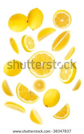 Fresh lemons on white background - stock photo