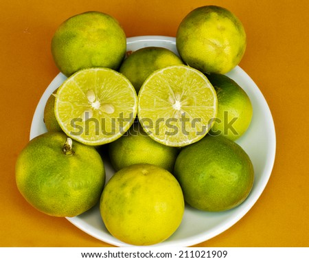 Fresh lemons on White dish - stock photo