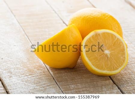 Fresh lemons on white wooden background. Selective focus. - stock photo