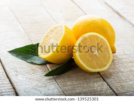 Fresh lemons on wooden background. Selective focus. - stock photo