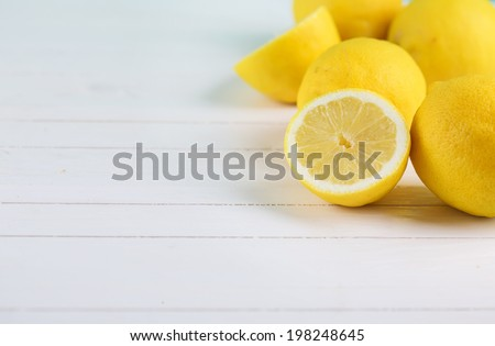 Fresh lemons  on  wooden background. Selective focus, horizontal. - stock photo