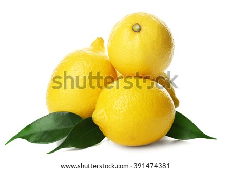 Fresh lemons with green leaves isolated on white - stock photo