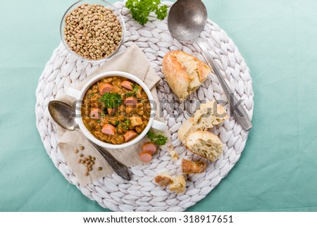 fresh lentil stew with sausages and parsley - stock photo