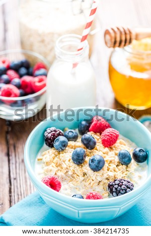 Fresh, light and tasty breakfast with summer fruits and fresh milk. - stock photo
