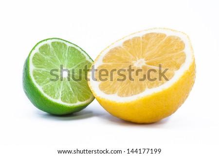 Fresh lime and lemon isolated on white background - stock photo