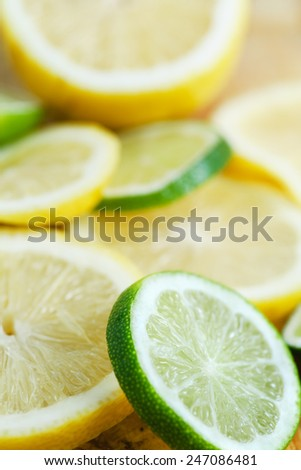 Fresh lime and lemon Slices of various citrus fruits with shallow depth of field background - stock photo
