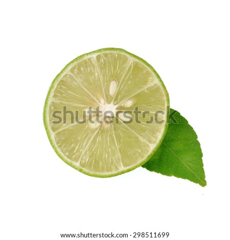 Fresh lime and slice isolated on white background - stock photo