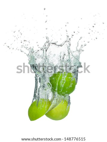 Fresh lime falling into water, isolated on white background