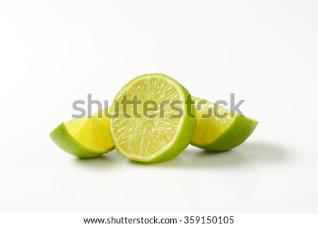 Fresh lime fruit half and wedges
