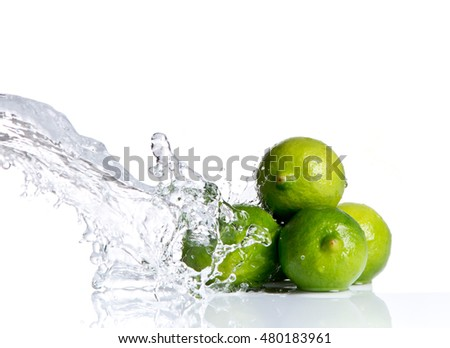 Fresh lime, fruits falling in water splash, isolated on white background