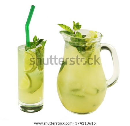 Fresh lime juice in glass jug and glasses on white background