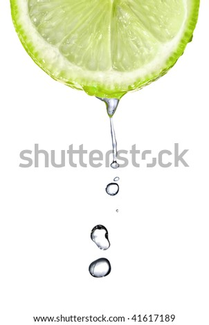 Fresh lime slice with water drops isolated on white - stock photo