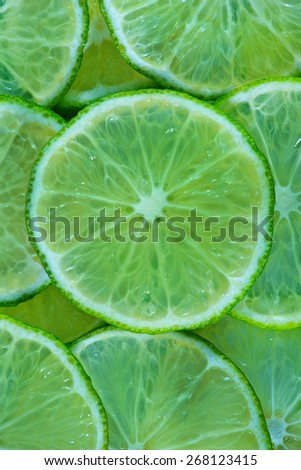 fresh lime, sliced of fresh lime, lime background - stock photo