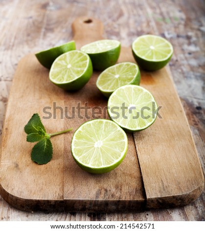 Fresh limes and mint - stock photo
