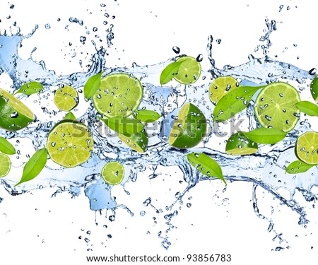 Fresh limes falling in water splash, isolated on white background - stock photo