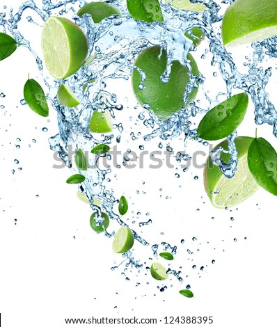Fresh limes in water splash - stock photo