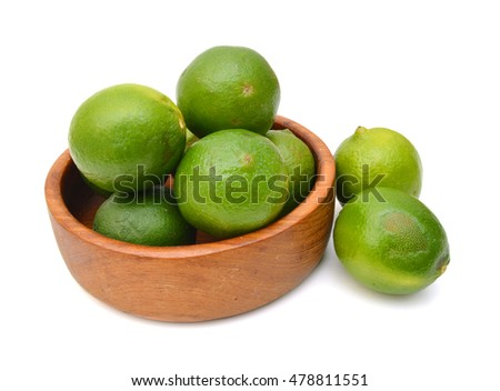 Fresh limes Isolated in wooden bowl on white