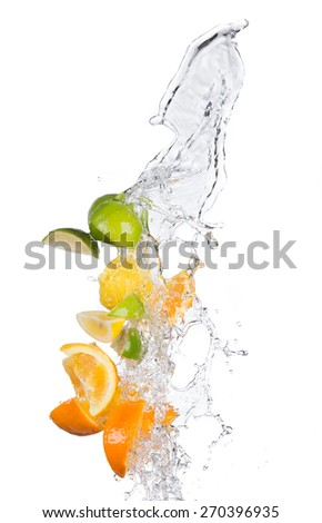Fresh limes, lemons and oranges with water splashes isolated on white background - stock photo