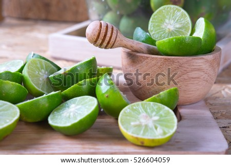 Fresh limes on a cutting board prepare for lime juice
