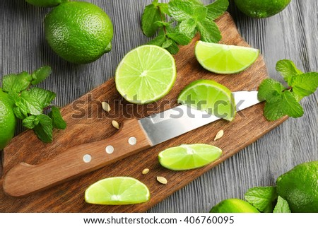 Fresh limes on cutting board - stock photo