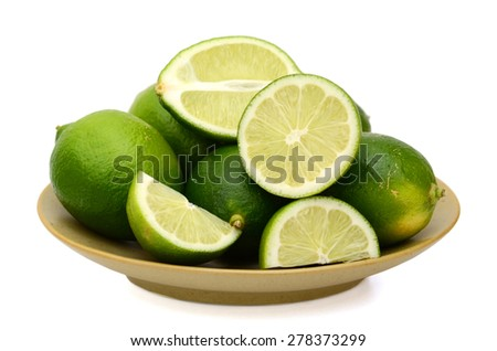fresh limes on plate isolated on white  - stock photo