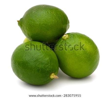 fresh limes on white bac ground - stock photo