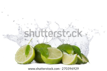 Fresh limes with water splashes isolated on white background - stock photo