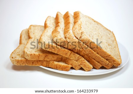 Fresh loaf of oat bread isolated - stock photo