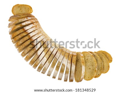 Fresh loaf of sliced rosemary and potato bread arranged in a crescent shape with the slices splayed, viewed from above isolated on white with copy space