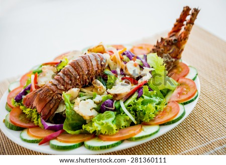 Fresh lobster with seafood sald. Restaurant - stock photo