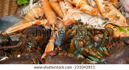 Fresh lobsters and crayfish in wicker basket at fish market in Senlis (Picardy, France) - stock photo