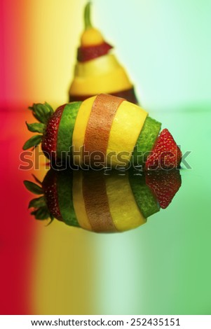 fresh local organic produce cut into slices and reassembled into a super veggie fruit - stock photo