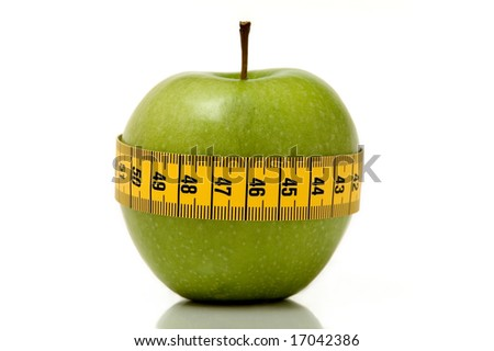 fresh looking apple surrounded by measuring tape