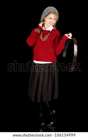 Fresh Looking Young Beauty Removing her Belt.  Isolated on black. - stock photo