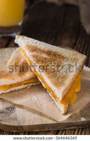 Fresh made Cheese Sandwich (selective focus) on an old wooden table - stock photo
