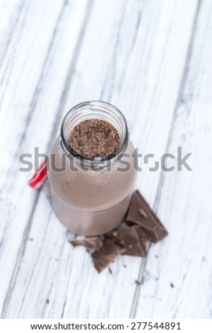 Fresh made Chocolate Milk on a bright wooden background - stock photo