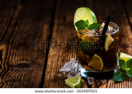 Fresh made Cuba Libre with brown rum and tasty lime - stock photo