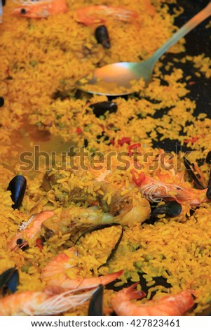 Fresh made Paella on a french market - stock photo