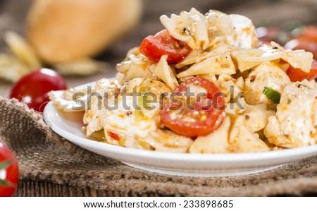 Fresh made Pasta Salad (with Farfalle; Feta Cheese and Tomatoes) - stock photo