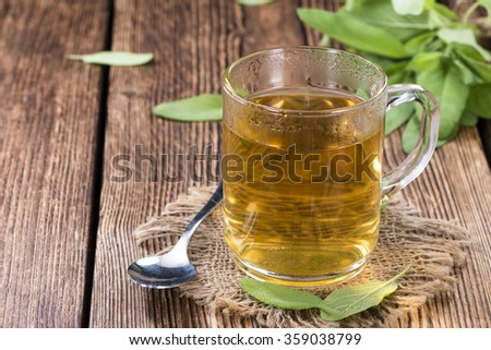 Fresh made Sage Tea (on vintage wooden background) as detailed close-up shot - stock photo